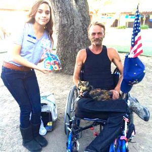 Our volunteer who is our youth ambassador is bringing a disabled homeless veteran food, carrier, toys for his cat.
