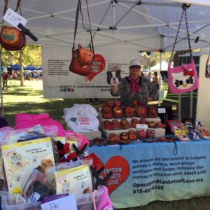 OBOL's booth at a pet adoption event. Our volunteer Laurie will be fundraising. She will meet 100's of attendees to tell them about OBOL.