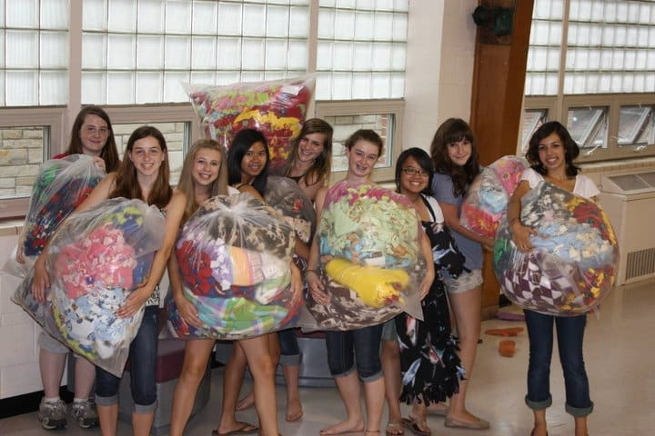 Girl Scouts show off their handmade blankets.