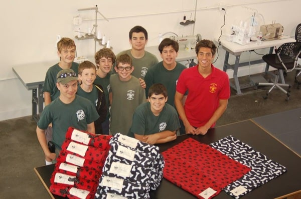 Eagle Scout had his fellow troop make blankets from rolls of fleece.