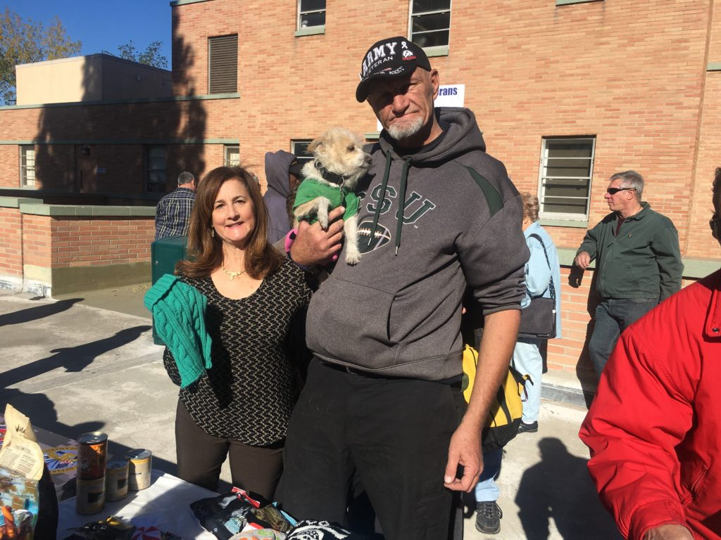 A homeless veteran thanks OOL to get new outfits for his pup! Plus tons of food and treats. They also got free vet care for his senior dog.q