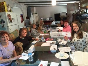 Our volunteers helping to do more mailings to raise funds for OBOL.