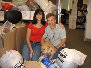 Eileen, Brad and Ginger picking up donations from a retirement home.