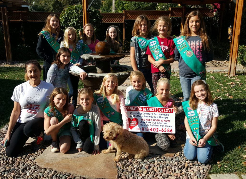 Girl Scouts earn their Pet Badges at OBOL Headquarters.