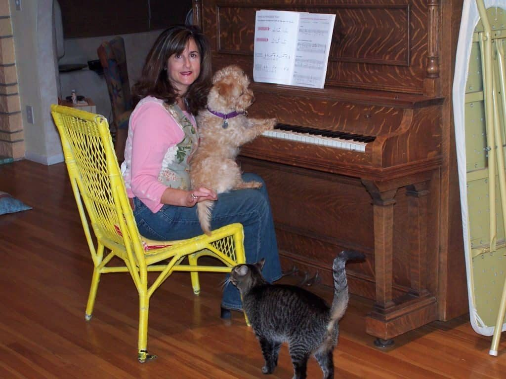 Ginger playing the piano and entertaining Eileen and her brother Sammy.