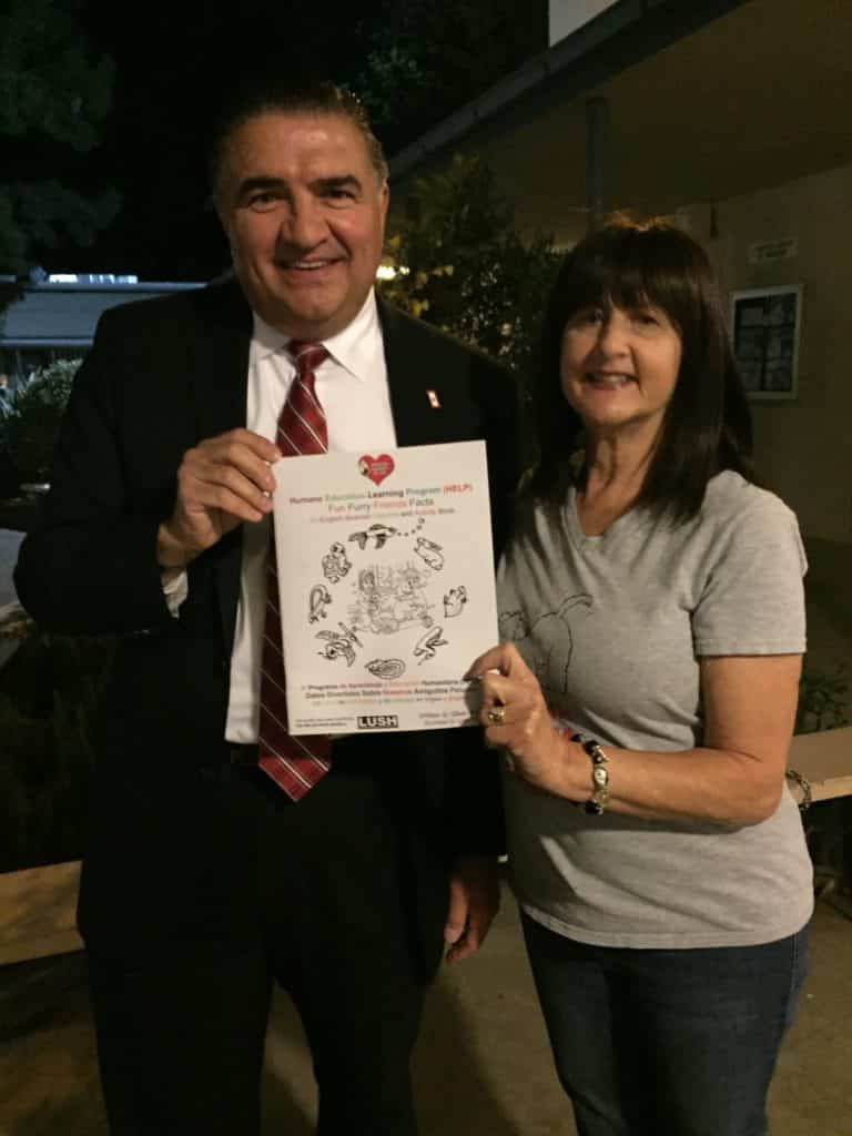 Assemblyman Dante Acosta,a supporter of OBOL and an avid animal activist for animal welfare. He is with Eileen showing the new Humane Education Learning Program activity/workbook that will be taught in schools.