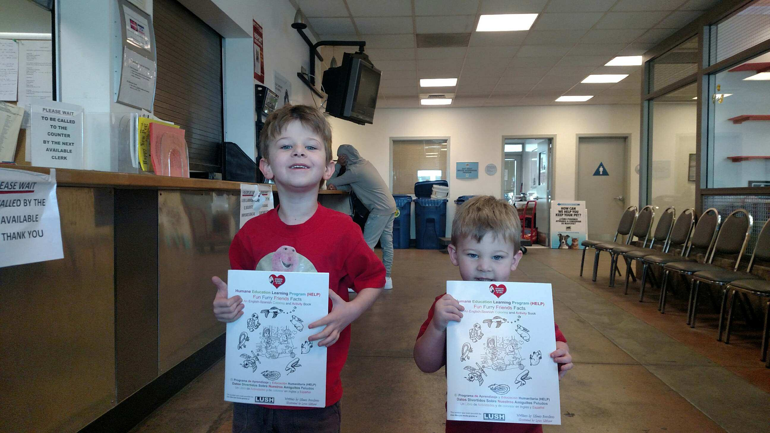 Children receive a free OBOL coloring and activity workbook while at a shelter.